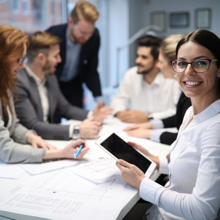 Cheerful coworkers in office during company meeting